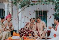 """<p>The decor of a traditional Indian wedding is dramatic, bold, and festive in the most otherworldly of ways. Guests can expect the most jaw-dropping display of color, but it's the fine details that stand out—even at a ceremony packed with plush textures, embroidered fabrics, and vibrant hues. </p><p>Take the dangling blooms and candles at Diipa and Oleg's wedding (pictured here), which add texture and visual interest to the look of their mandap, and would just as beautifully complement any wedding altar. Choose a bloom or ornament that works for your color palette, floral design, and overall look. Then, take notes from this ceremony, where fluttering blooms and candles worked to create """"walls"""" around the couple and their family, making the space feel simultaneously intimate and open.<br></p><p><em>Pictured: <a href=""""https://www.harpersbazaar.com/wedding/photos/a25397587/diipa-khosla-oleg-buller-wedding/"""" rel=""""nofollow noopener"""" target=""""_blank"""" data-ylk=""""slk:Diipa and Oleg's 4-day Wedding in India"""" class=""""link rapid-noclick-resp"""">Diipa and Oleg's 4-day Wedding in India</a>; Planning by <a href=""""https://www.ankit.in/"""" rel=""""nofollow noopener"""" target=""""_blank"""" data-ylk=""""slk:Ankit"""" class=""""link rapid-noclick-resp"""">Ankit</a>; Design and florals by <a href=""""http://www.altair-decor.com/"""" rel=""""nofollow noopener"""" target=""""_blank"""" data-ylk=""""slk:Alt Air"""" class=""""link rapid-noclick-resp"""">Alt Air</a>. </em></p>"""