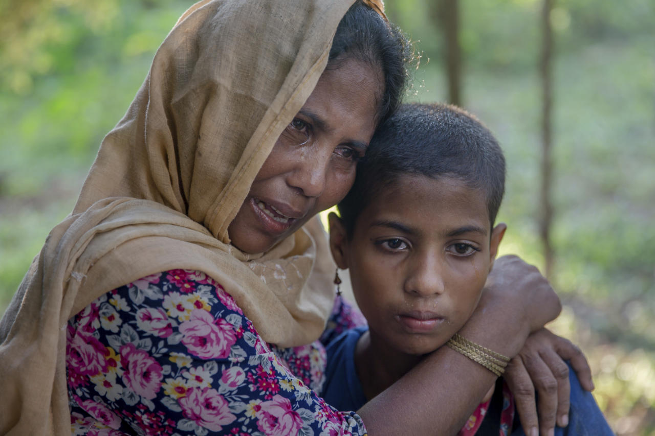 Noor Mehar, a Rohingya Muslim woman, who crossed over from Myanmar into Bangladesh, along with her daughter Rasheeda, grieves for her three daughters after their boat capsized near Shah Porir Dwip, Bangladesh, Monday, Oct. 16, 2017. An overcrowded boat carrying Rohingya Muslims fleeing Myanmar capsized Monday in the Bay of Bengal near a Bangladeshi fishing village, killing 12 people, including six children, police said.(AP Photo/Dar Yasin)