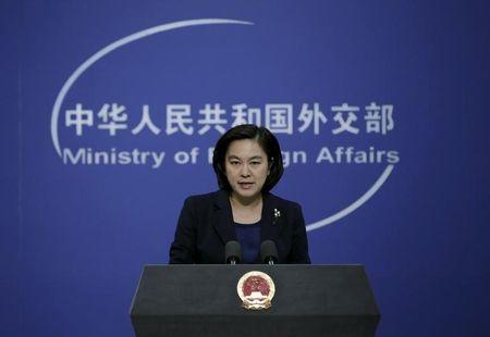 Hua Chunying, spokeswoman of China's Foreign Ministry, speaks at a regular news conference, in Beijing