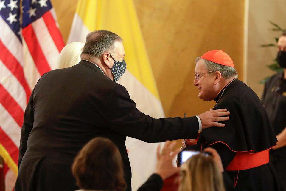 """U.S. Secretary of State Mike Pompeo, left, greets Cardinal Raymond Burke as they attend the """"Advancing and Defending International Religious Freedom Through Diplomacy"""" symposium, in Rome, Wednesday, Sept. 30, 2020. (AP Photo/Andrew Medichini) (Photo: ASSOCIATED PRESS)"""