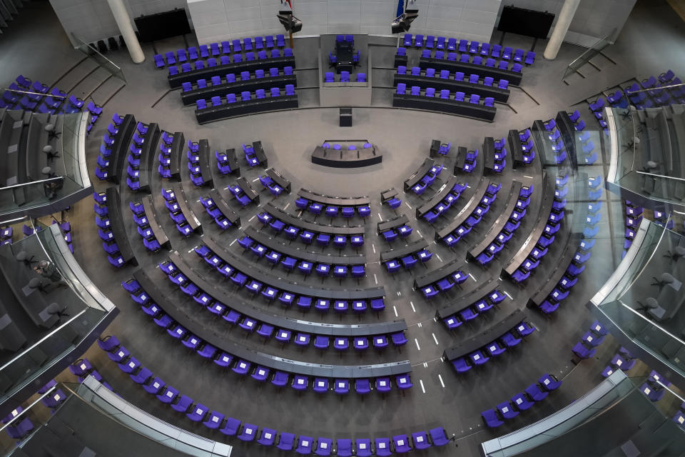 A general view inside the plenary hall of the German parliament Bundestag at the Reichstag Building in Berlin, Germany, Thursday, Sept. 16, 2021. German voters elect a new parliament on Sunday, Sept. 26, 2021, a vote that will determine who succeeds Chancellor Angela Merkel after her 16 years in power. (AP Photo/Markus Schreiber)