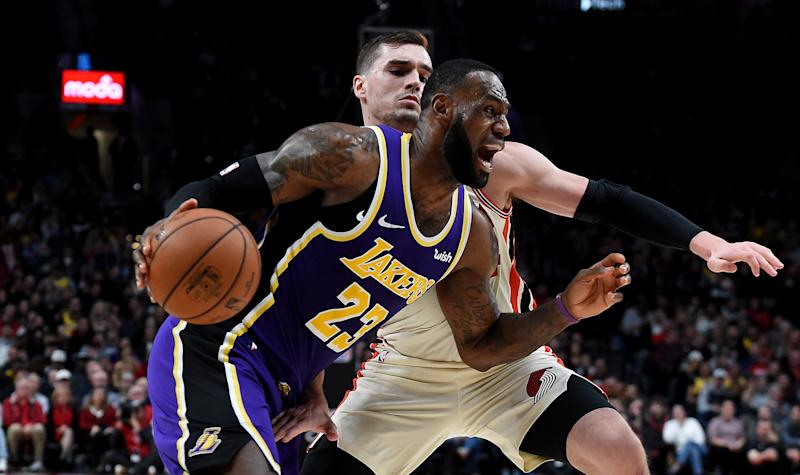 PORTLAND, OREGON - DECEMBER 06: LeBron James #23 of the Los Angeles Lakers drives to the basket on Mario Hezonja #44 of the Portland Trail Blazers during the second half of the game at Moda Center on December 06, 2019 in Portland, Oregon. The Lakers won 136-113. NOTE TO USER: User expressly acknowledges and agrees that, by downloading and or using this photograph, User is consenting to the terms and conditions of the Getty Images License Agreement. (Photo by Steve Dykes/Getty Images)