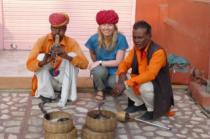 Angela Saurine with snake charmers in India. Photo: Supplied