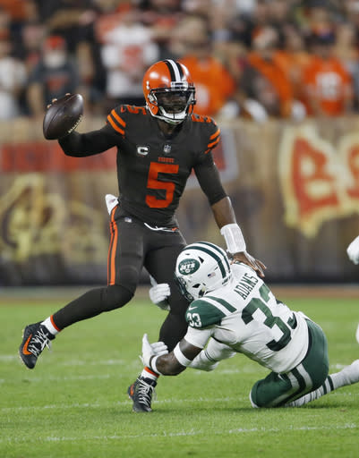 New York Jets defensive back Jamal Adams (33) tackles Cleveland Browns quarterback Tyrod Taylor (5) during the first half of an NFL football game, Thursday, Sept. 20, 2018, in Cleveland. (AP Photo/Ron Schwane)