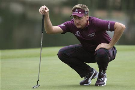 Poulter of England looks over his putt on the 18th green during the third round of the WGC-HSBC Champions golf tournament in Shanghai
