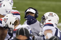 Arizona coach Kevin Sumlin looks up at the scoreboard during a timeout in the first half of the team's NCAA college football game against Washington on Saturday, Nov. 21, 2020, in Seattle. (AP Photo/Elaine Thompson)
