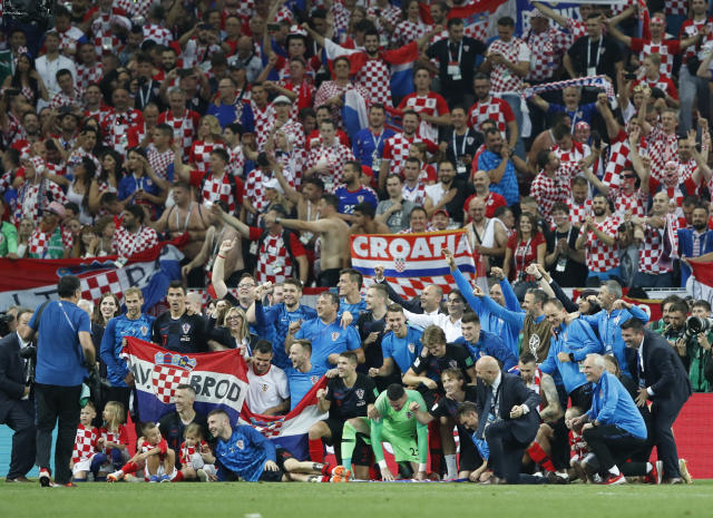 Croatia team celebrates at the end of the semifinal match between Croatia and England at the 2018 soccer World Cup in the Luzhniki Stadium in Moscow, Russia, Wednesday, July 11, 2018. (AP Photo/Rebecca Blackwell)
