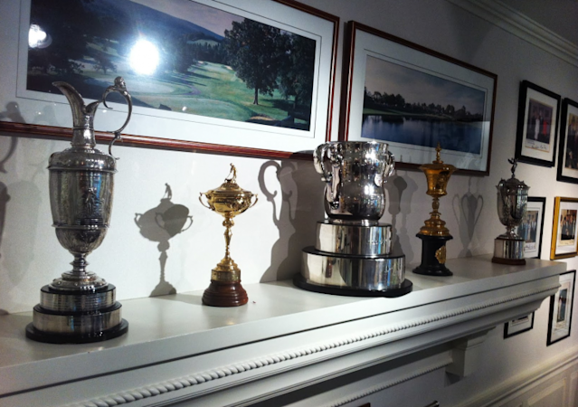 Trophies at Arnold Palmer's office include the British Open's Claret Jug and the Ryder Cup and U.S. Open trophies. (Yahoo Sports)