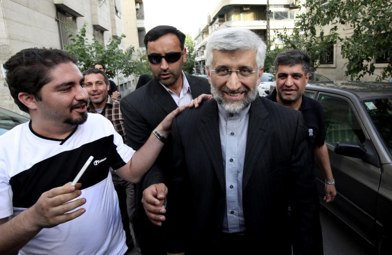 Iranian presidential candidate Saeed Jalili, center right, Iran's top nuclear negotiator, arrives at a campaign rally attended by his female supporters, in Tehran, Iran, Wednesday, May 29, 2013. Iran will hold its 11th presidential elections after 1979 Islamic Revolution, on June 14. (AP Photo/Vahid Salemi)
