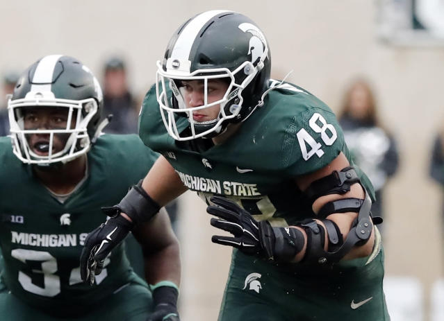 FILE - In this Oct. 20, 2018, file photo, Michigan State defensive end Kenny Willekes rushes the line during the second half of an NCAA college football game against Michigan in East Lansing, Mich. Ohio State visits Michigan State needing a win to stay on track for a Big Ten East showdown with Michigan in two weeks. (AP Photo/Carlos Osorio, File)