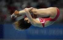 Shi Tingmao of China competes in women's diving 3m springboard final at the Tokyo Aquatics Centre at the 2020 Summer Olympics, Sunday, Aug. 1, 2021, in Tokyo, Japan. (AP Photo/Dmitri Lovetsky)