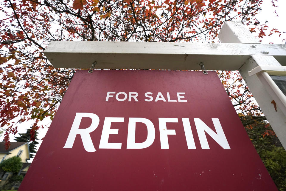 "A Redfin ""for sale"" sign stands in front of a house Wednesday, Oct. 28, 2020, in Seattle. Several fair housing organizations accused Redfin of systematic racial discrimination in a lawsuit Thursday, saying the online real estate broker offers fewer services to homebuyers and sellers in minority communities, a type of ""digital redlining"" that has depressed home values and exacerbated historic injustice in the housing market. (AP Photo/Elaine Thompson)"
