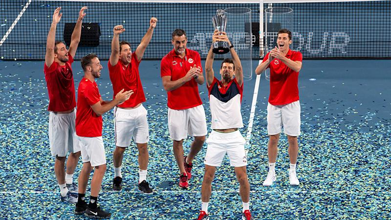 Novak Djokovic, pictured here lifting the trophy after leading Serbia to victory.