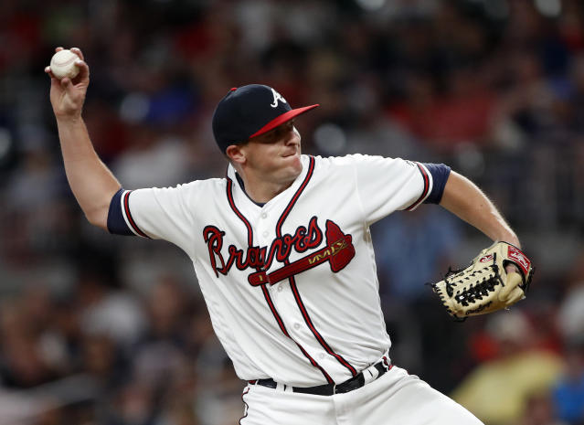 FILE - In this July 30, 2018, file photo, Atlanta Braves relief pitcher Brad Brach works in the eighth inning of a baseball game against the Miami Marlins Monday, July 30, 2018 in Atlanta. Brach and Tony Barnette join a Chicago Cubs bullpen that finished with a 3.35 ERA last year, second in the majors behind Houston. Brach posted a 1.52 ERA in 27 appearances after he was traded from Baltimore to Atlanta on July 30. Barnette went 2-0 with a 2.39 ERA in 22 games for Texas. (AP Photo/John Bazemore, File)