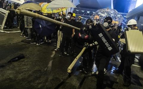 Protesters and police clashed after a mass rally in Hong Kong - Credit: Justin Chin/Bloomberg