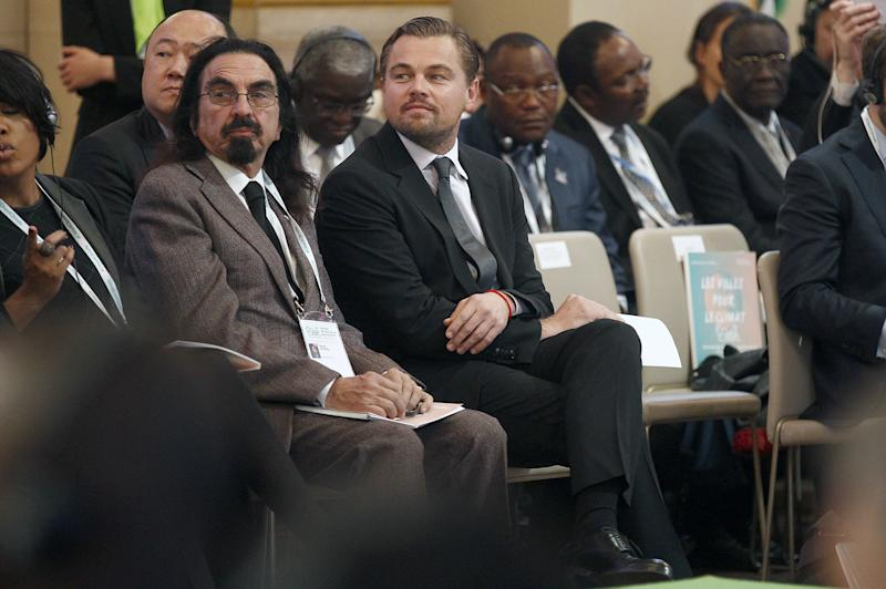 George DiCaprio and his son Leonardo DiCaprio attend the COP21, Paris Climate Conference, at city hall in Paris, December 2015.