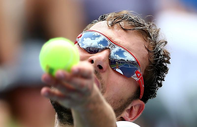 Jerzy Janowicz of Poland serves to Lukas Rosol of the Czech Republic during the men's finals match of the Winston-Salem Open on August 23, 2014 (AFP Photo/Streeter Lecka)