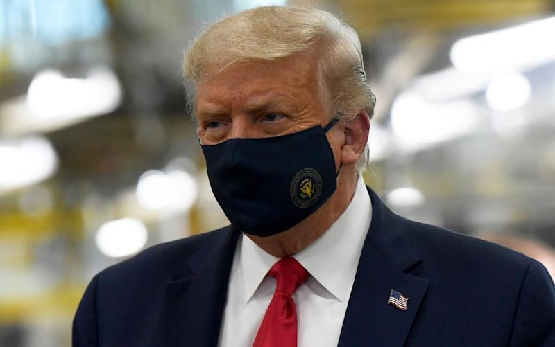 President Donald Trump wears a mask as he tours the Whirlpool Corporation facility in Clyde, Ohio, on August 6 - AP Photo/Susan Walsh