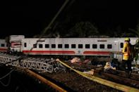 Rescuers search an overturned train in Yilan, Taiwan October 21, 2018. REUTERS/Lee Kun Han