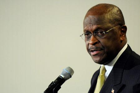 FILE PHOTO: Former Republican presidential hopeful Herman Cain in Washington January 24, 2012. REUTERS/Jonathan Ernst/File Photo