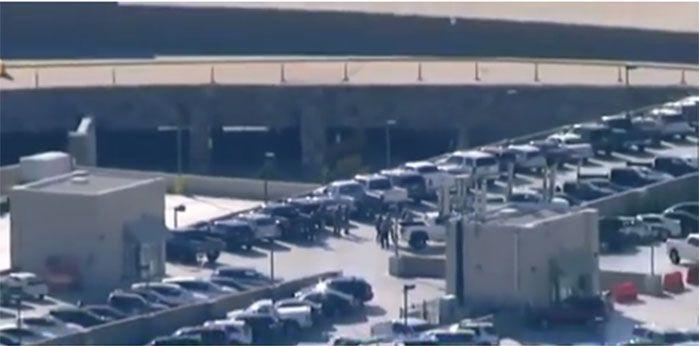 Armed police in the airport's carpark. Image: 7 News