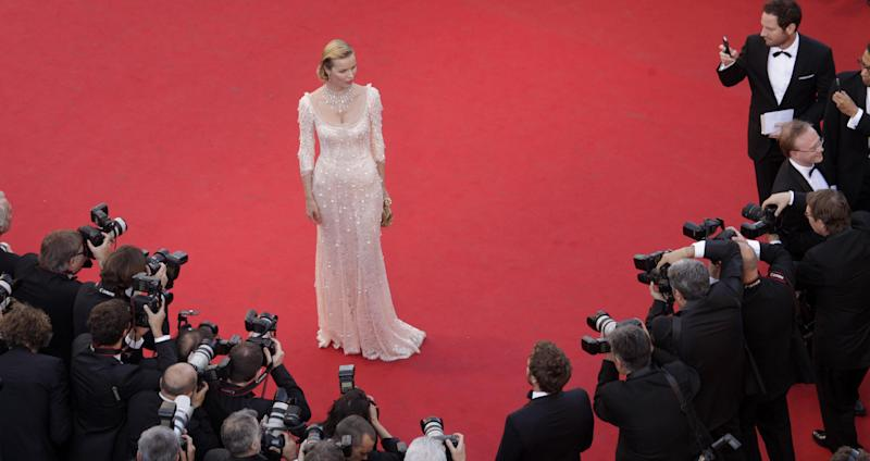 Model Eva Herzigova poses for photographers during the opening ceremony and screening of Moonrise Kingdom at the 65th international film festival, in Cannes, southern France, Wednesday, May 16, 2012. Herzigova is wearing a dress by Dolce & Gabbana. (AP Photo/Virginia Mayo, Pool)