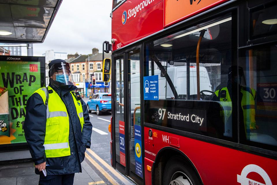 <p>TfL workers take part in a crackdown on bus passengers not wearing masks in Walthamstow</p> (Lucy Young)