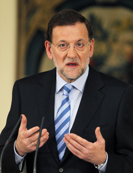 Spain's Prime Minister Mariano Rajoy gestures during a press conference at the Moncloa Palace, in Madrid, Sunday, June 10, 2012. Spain became the fourth and largest country to ask Europe to rescue its failing banks, a bailout of up to 100 billion euros ($125 billion) that leaders hoped would stabilize a financial crisis that threatens to break apart the 17-country eurozone. (AP Photo/Andres Kudacki)