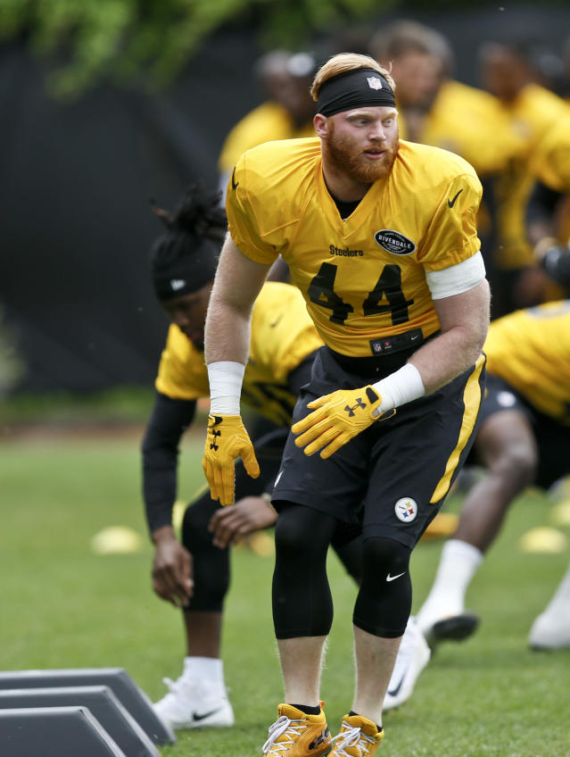 "FILE - In this May 22, 2018, file photo, Pittsburgh Steelers linebacker Tyler Matakevich (44) runs a drill during NFL football practice in Pittsburgh. Mike Tomlin gave Tyler Matakevich the nickname ""Dirty Red"" when the Steelers linebacker was a rookie as a tribute to his mane of red hair and his relentless play. (AP Photo/Keith Srakocic, File)"