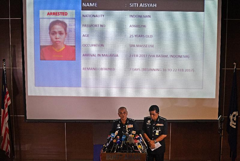 Siti Aisyah (pictured, top, during a Malaysian Police press conference), an Indonesian suspect in the killing of Kim Jong-Nam, says she was paid just $90 for her role in the murder (AFP Photo/Mohd RASFAN)