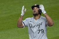 Chicago White Sox's Jose Abreu reacts as he crosses the plate after he hit a grand slam during the eighth inning of a baseball game against the Seattle Mariners, Tuesday, April 6, 2021, in Seattle. (AP Photo/Ted S. Warren)