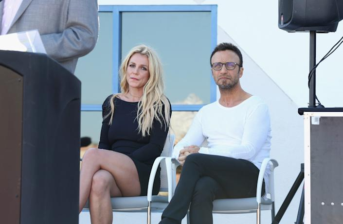 Britney Spears and talent manager Larry Rudolph listen to Clark County Commissioner Steve Sisolak's speech during the grand opening of the Nevada Childhood Cancer Foundation Britney Spears Campus on Nov. 4, 2017, in Las Vegas.
