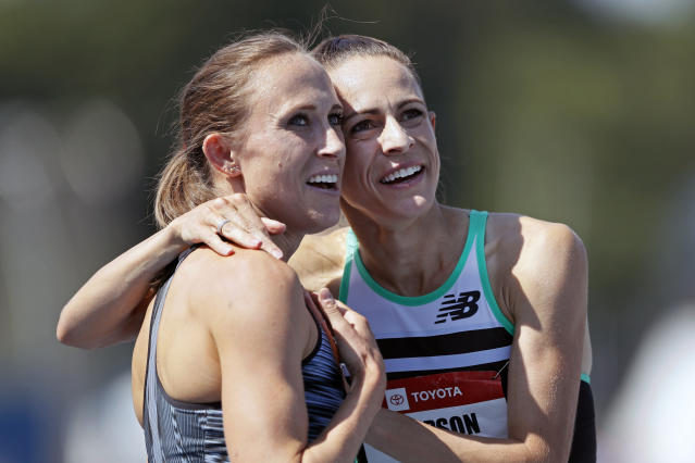 Shelby Houlihan gets a hug from Jenny Simpson, right, after winning the women's 1500-meter run at the U.S. Championships athletics meet, Saturday, July 27, 2019, in Des Moines, Iowa. (AP Photo/Charlie Neibergall)