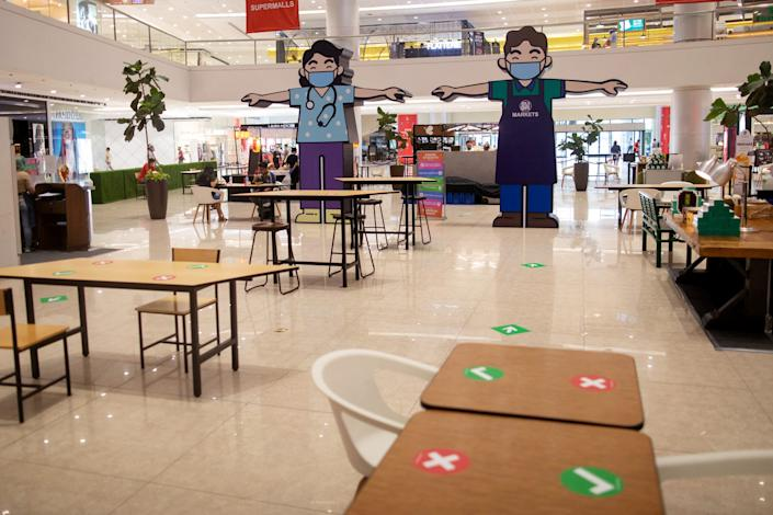 """Billboards of characters wearing masks and maintaining social distancing are placed in the middle of a shopping mall in Metro Manila, Philippines, on June 16, 2020. <p class=""""copyright"""">REUTERS/Eloisa Lopez</p>"""