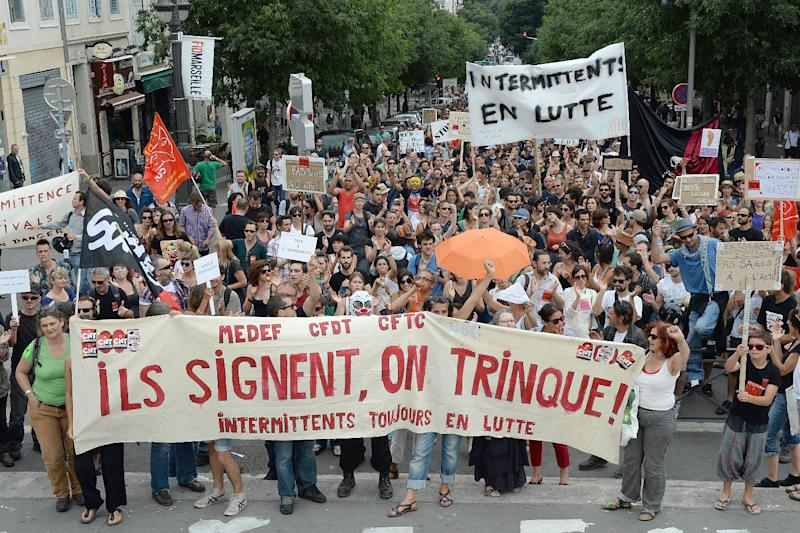 Artists, technicians, part-time workers employed in the entertainment industry demonstrate in Marseille, southern France, on June 16, 2014, to protest against government cuts to their unemployment benefits (AFP Photo/Boris Horvat)