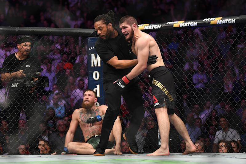 LAS VEGAS, NV - OCTOBER 06: (R-L) Khabib Nurmagomedov of Russia reacts after submitting Conor McGregor of Ireland in their UFC lightweight championship bout during the UFC 229 event inside T-Mobile Arena on October 6, 2018 in Las Vegas, Nevada. (Photo by Jeff Bottari/Zuffa LLC/Zuffa LLC via Getty Images)