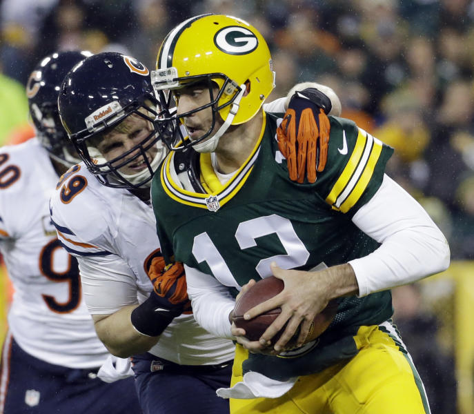 Green Bay Packers quarterback Aaron Rodgers is sacked by Chicago Bears' Shea McClellin during the first half of an NFL football game Monday, Nov. 4, 2013, in Green Bay, Wis. (AP Photo/Morry Gash)