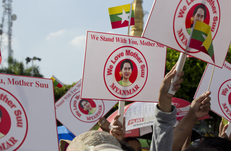 People hold placards with picture of Myanmar leader Aung San Suu Kyi during a rally Sunday, Dec. 1, 2019, in Yangon, Myanmar. About 700 people rallied Sunday to show support for Myanmar's leader, Aung San Suu Kyi, as she prepares to defend the country against charges of genocide at the U.N.'s highest court. (AP Photo/Thein Zaw)
