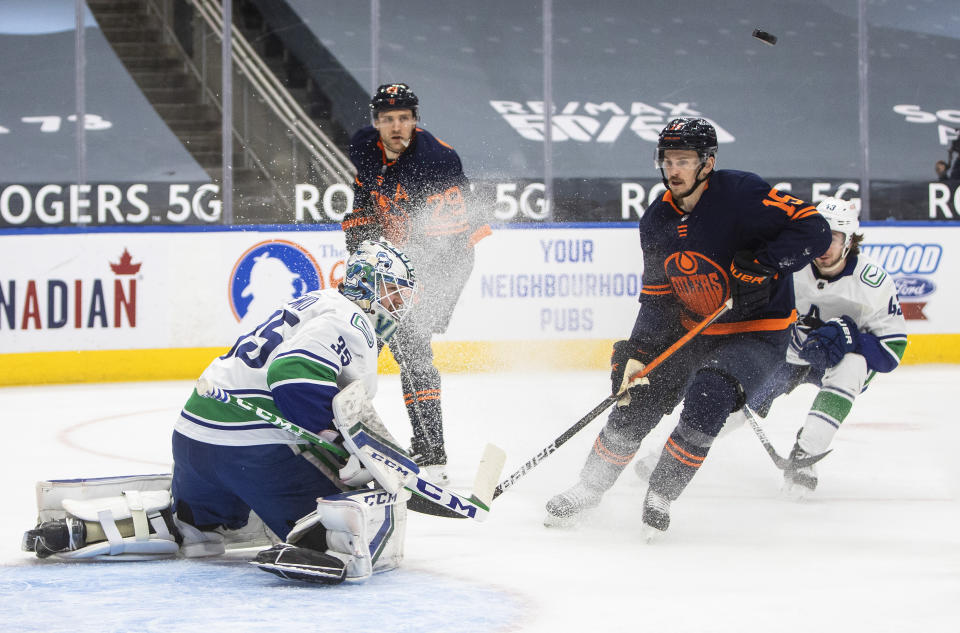 Edmonton Oilers' Josh Archibald (15) is stopped by Vancouver Canucks goalie Thatcher Demko (35) during the second period of an NHL hockey game Saturday, May 8, 2021, in Edmonton, Alberta. (Jason Franson/The Canadian Press via AP)