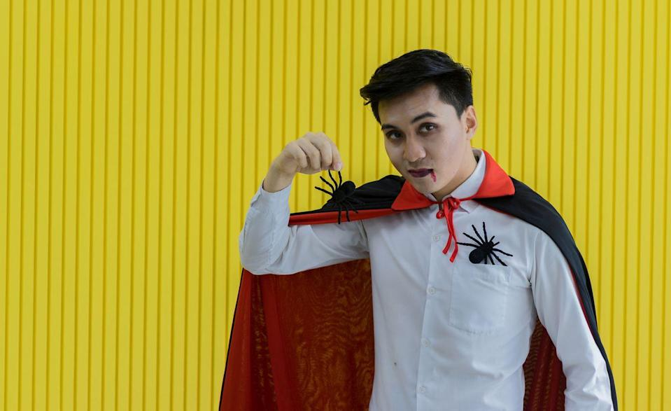 """<p>For a costume that definitely doesn't suck, pair a white button-up shirt with a red-and-black cape and some fake blood. </p><p><a class=""""link rapid-noclick-resp"""" href=""""https://www.amazon.com/IMIKEYA-Halloween-Vampire-Reversible-Cosplay/dp/B08HGPL5TJ?tag=syn-yahoo-20&ascsubtag=%5Bartid%7C10070.g.490%5Bsrc%7Cyahoo-us"""" rel=""""nofollow noopener"""" target=""""_blank"""" data-ylk=""""slk:SHOP CAPES"""">SHOP CAPES</a></p>"""