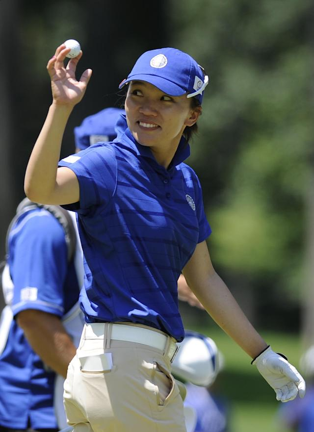 Teresa Lu, of Taiwan, smiles to the gallery after making an eagle on the first hole during the third round of the International Crown golf tournament on Saturday, July 26, 2014, in Owings Mills, Md.(AP Photo/Gail Burton)