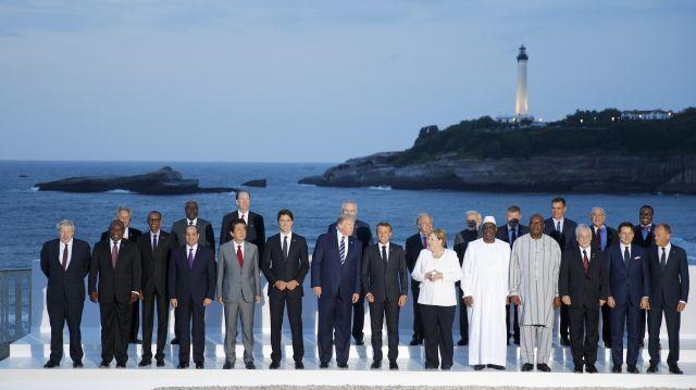 Group of Seven leaders and guests pose for the G7 family photo Sunday, Aug. 25, 2019 in Biarritz.
