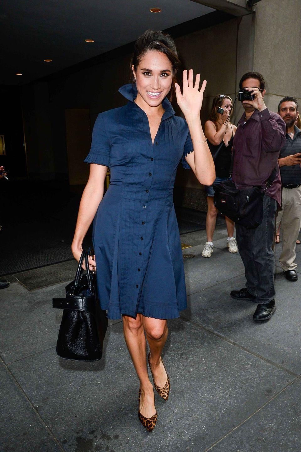 "<p>She looks polished in a classic navy dress with <a href=""https://www.sarahflint.com/products/emma-chocolate-leopard?variant=37841859521"" rel=""nofollow noopener"" target=""_blank"" data-ylk=""slk:leopard print pumps from Sarah Flint"" class=""link rapid-noclick-resp"">leopard print pumps from Sarah Flint</a>.</p>"