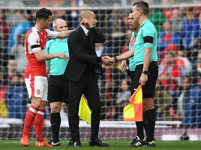 Guardiola lets his thoughts be known to the match officials after the final whistle (Getty)