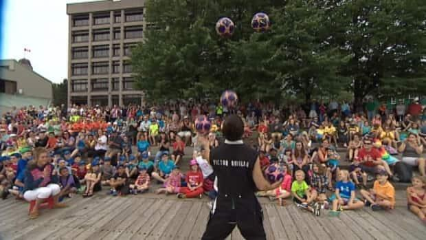 A busker entertains the crowd at a previous Halifax Busker Festival in this file photo. Performances this year will be limited to one stage, with only musicians and magicians participating.  (CBC - image credit)