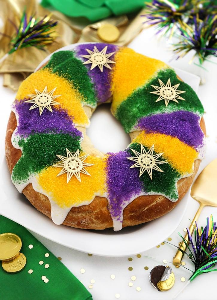 """<p>Bow down, because this king cake recipe reigns above all. With bright, fun flavors and the iconic colors of the celebration, this cake will give anyone a sugar rush. Enjoy!</p> <p><strong>Get the recipe</strong>: <a href=""""https://www.sprinklebakes.com/2020/02/mardi-gras-king-cake.html"""" class=""""link rapid-noclick-resp"""" rel=""""nofollow noopener"""" target=""""_blank"""" data-ylk=""""slk:Mardi Gras king cake"""">Mardi Gras king cake</a></p>"""