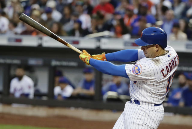 New York Mets' Asdrubal Cabrera follows through on a RBI double during the third inning of a baseball game against the Miami Marlins Monday, May 21, 2018, in New York. (AP Photo/Frank Franklin II)