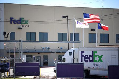 A FedEx truck is seen outside FedEx facility following the blast, in Schertz, Texas