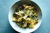 """Bacon gives an underlying current of smoky richness to this flavorful spring pasta recipe. <a href=""""https://www.epicurious.com/recipes/food/views/pappardelle-pasta-with-chicken-ragu-fennel-and-peas?mbid=synd_yahoo_rss"""" rel=""""nofollow noopener"""" target=""""_blank"""" data-ylk=""""slk:See recipe."""" class=""""link rapid-noclick-resp"""">See recipe.</a>"""