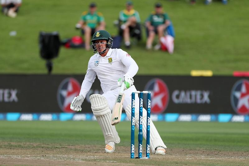 Quinton de Kock of South Africa runs between the wickets on day two of the third Test cricket match against South Africa at Seddon Park in Hamilton on March 26, 2017